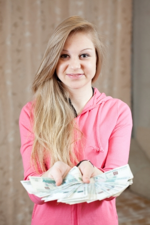happy casual girl with many  money in home inter Stock Photo - 14595105