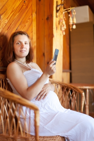 gravida:  pregnancy woman reads e-book in home interior
