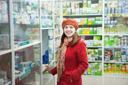 Woman near counter in pharmacy drugstore photo