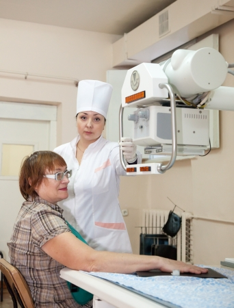 doctor radiologist makes a hand x-ray of woman  in clinic Stock Photo - 14604840