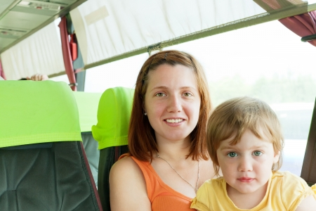 motorbus: Mother and child traveling in autobus.  Focus o woman