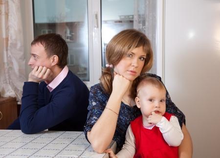 Family of three having quarrel at home Stock Photo - 14710350