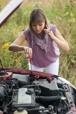 Young woman trying to fix the car Stock Photo - 14724152