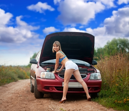 Sexy woman trying to fix the car outdoor Stock Photo - 14724161