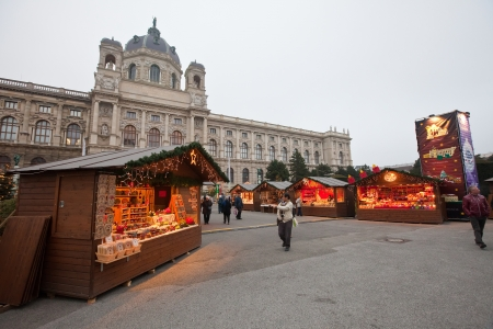 VIENNA, AUSTRIA - NOVEMBER 22: People walking at  Christmas Market at Maria-Theresien-Platz   in November 22, 2011 in Vienna, Austria.  Maria-Theresien-Platz is a large square and a popular tourist site in Vienna.