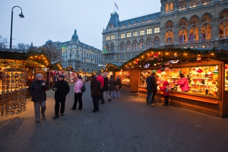 VIENNA, AUSTRIA - NOVEMBER 22: People  walking at  traditional Christmas market near old town hall  in November 22, 2011 in Vienna, Austria. This market is focused on authentic handicrafts made by local artists