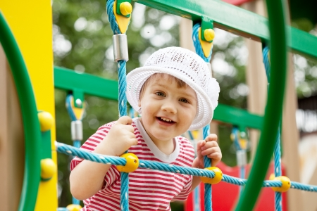 Portrait of two-year child at playground area in summer photo