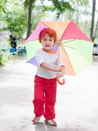 1 2 years: Two-year baby girl with umbrella in summer