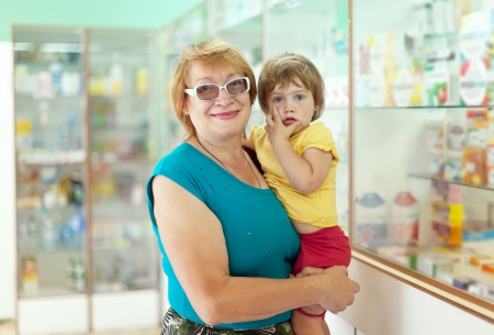Mature woman with child chooses drugs at the pharmacy Stock Photo - 14725837