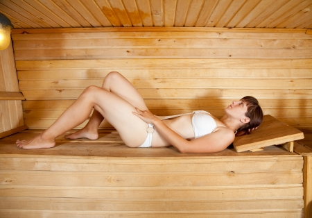 finnish bath: Young woman lying at sauna bath