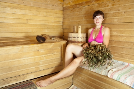 Young woman take steam bath at sauna Stock Photo - 14730707