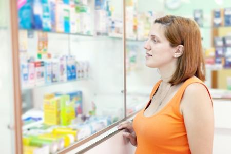 gravida:  woman chooses drugs at the pharmacy drugstore