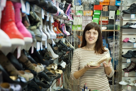 woman chooses shoes at fashionable shop Stock Photo - 14730591