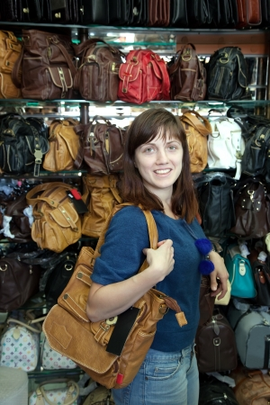 woman chooses leather bag at  shop Stock Photo - 14730696