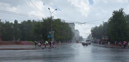 NIZHNY NOVGOROD, RUSSIA - JULY 19: Rain at city streets in July 19, 2012 in Nizhny Novgorod, Russia. The sun shines an average of 1775 hours per year at city