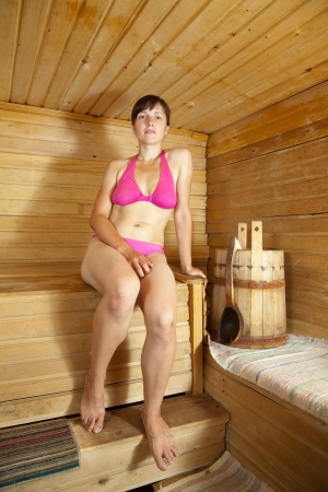 Young woman  taking steam-bath  at sauna  photo