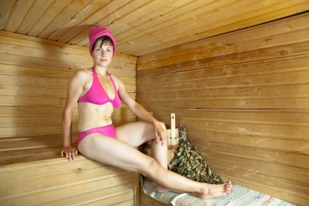 Young woman take steam bath at sauna photo