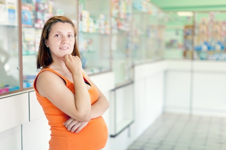 pregnant woman at the pharmacy drugstore photo