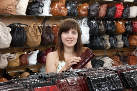 woman chooses leather wallet at  shop Stock Photo - 14757447