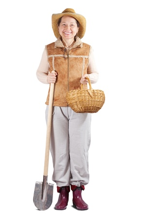 welly: full length shot of happy famale farmer  with spade over white Stock Photo