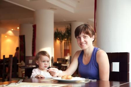 Family  having breakfast in hotel restaurant photo