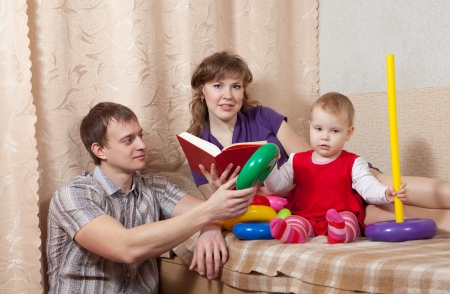 Family  relaxing at home on sofa Stock Photo - 14825286
