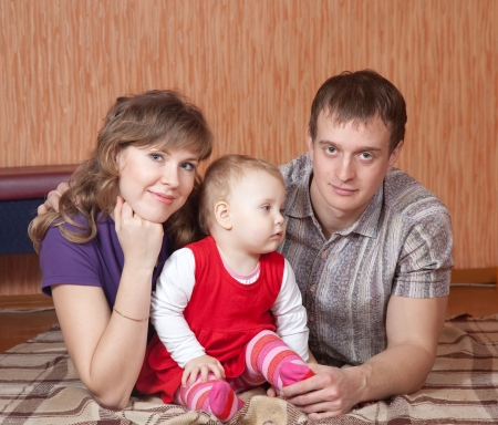 Family  relaxing at home on floor Stock Photo - 14825282