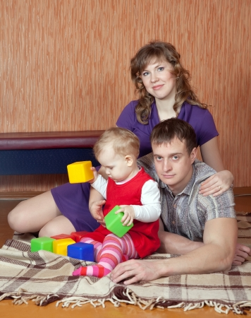 parents and child relaxing at home on floor Stock Photo - 14825279