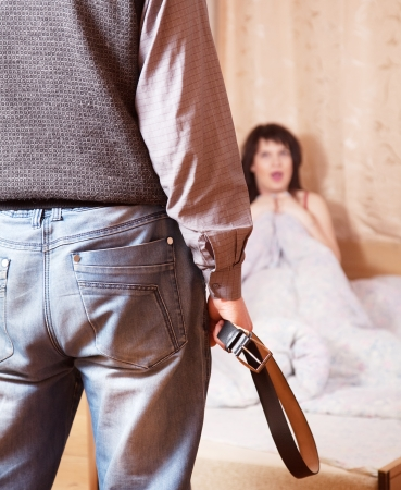Married couple having quarrel about adultery photo