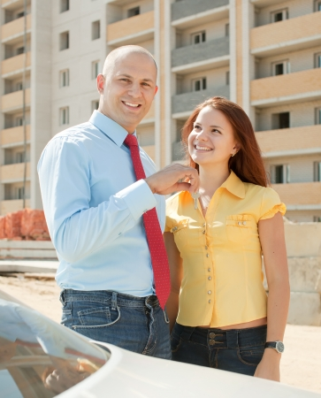 Happy couple with key against building new brick house Stock Photo - 15183512