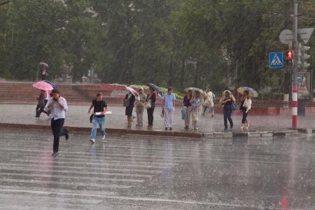 NIZHNY NOVGOROD, RUSSIA - JULY 19: Rain at city streets in July 19, 2012 in Nizhny Novgorod, Russia. The sun shines an average of 1775 hours per year at city Stock Photo - 14818853