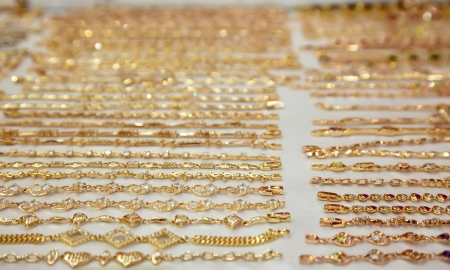 Golden bracelets on jewelry counter  in shop Stock Photo - 14926881