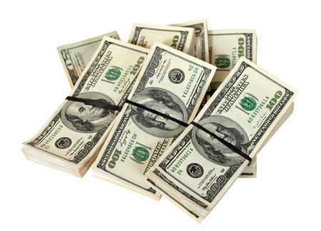 Many bundles of US dollars bank notes. Isolated on white background photo