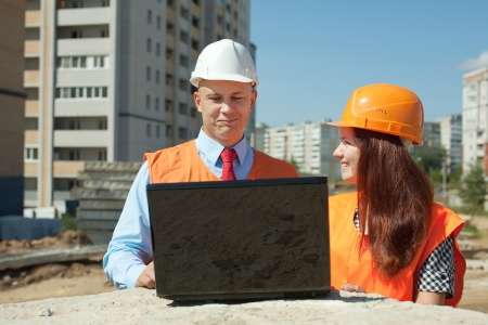 White-collar workers wearing protective helmet works on the building site photo