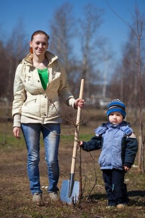 Mother and her 2-3 years old boy gardening photo