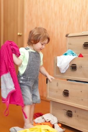 Baby girl  chooses dress in parent's closet   Stock Photo - 14901192