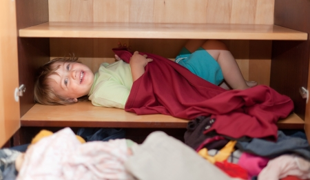 Baby girl is in the closet at home