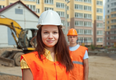 construction machines: Portrait of two builders works at construction site  Stock Photo
