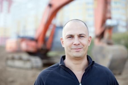 building site: Portrait of manual worker at building site