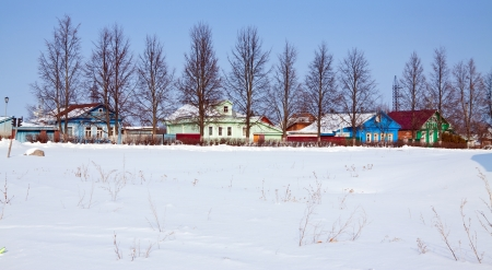 Wooden houses in winter street at Suzdal. Russia photo