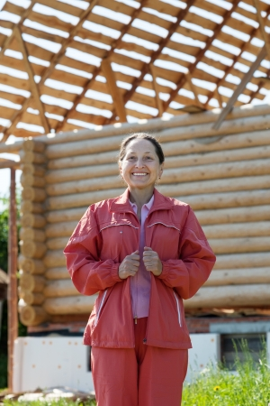 homeownership: Outdoor portrait of mature woman against building home