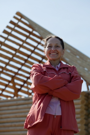 Outdoor portrait of mature woman against building home Stock Photo - 15044851