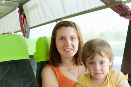 motorbus: Mother and child traveling in autobus. Focus on woman Stock Photo