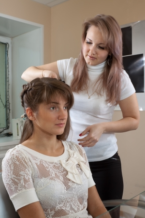 hair stylist work on woman hair in salon Stock Photo - 15126855