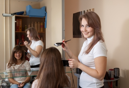 hairtician: Hairdresser coloring   long-haired girl hair  Stock Photo