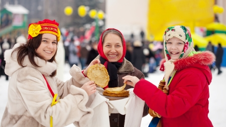 sudarium: Women with pancakes during  Maslenitsa festival in Russia Stock Photo