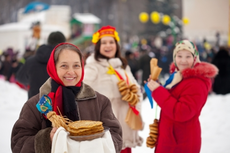 Girl  in traditional  clothes with pancake during  Maslenitsa festival photo