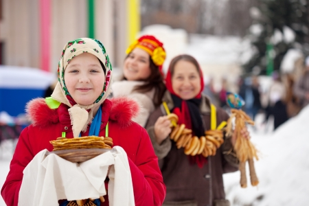Teenager girl with pancake during  Shrovetide at Russia photo
