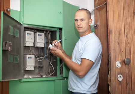 Man rewrites electric power meter readings at house photo