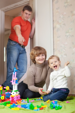 Happy mother and child plays with toys in home Stock Photo - 15256088
